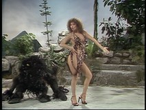 "Raquel Welch shows more skin than fabric in her racy opening dance number, ""I'm a Woman."""