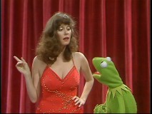 Lesley Ann Warren makes a point to Kermit outside the Muppet Theater's famous red stage curtain.