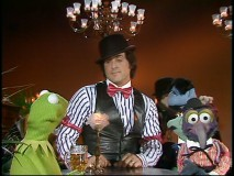 Wearing a top hat, bow tie, and vest, Sylvester Stallone looks dapper amidst the Muppets in his appearance. This was a half-life ago, when making Rocky sequels didn't yield age jokes.