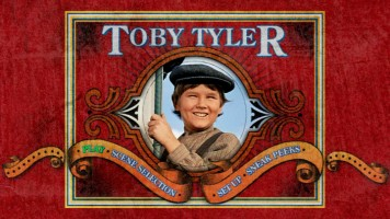 """Toby Tyler""'s Main Menu screen. Nowhere on the DVD is the full title featured. I guess the marketing department finally answered the original question."