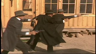 "Sam Elliott, Kurt Russell, and Bill Paxton film the picture's big action set piece: ""The Gunfight at the O.K. Corral."""