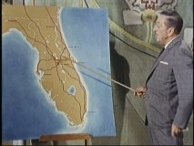 Walt points out the planned location for Disney World