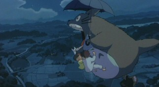 Totoro takes the girls on an exhilarating flight over the Japanese countryside, letting out a powerful roar.