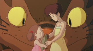 Mei explains to Satsuki her mission of delivering the ear of corn to their mother as the catbus looks on.