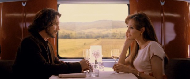 """The Tourist"" may not realize its Hitchockian ambitions, but it does feature some strangers on a train (Johnny Depp and Angelina Jolie)."