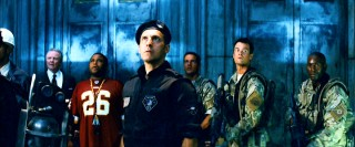 Five of the movie's male leads (Jon Voight, Anthony Anderson, John Turturro, skip, Josh Duhamel, and Tyrese Gibson) pose heroically.