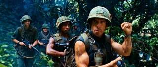 "Portraying author and Vietnam War hero ""Four Leaf"" Tayback, Tugg Speedman (Ben Stiller) leads his boys into the jungle with a clenched fist signal."