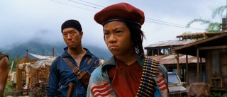 Young Tran (Brandon Soo Hoo) calls the shot and Byong (Reggie Lee) provides the muscle at the Vietnamese heroin camp causing our actors some strife.