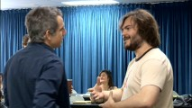 "A much longer and darker-haired Jack Black chats with a silver-haired Ben Stiller at a table read in ""Before the Thunder."""