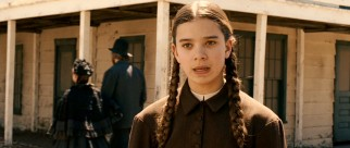 Pigtailed precocious 14-year-old protagonist Mattie Ross (Hailee Steinfeld) searches for a bounty hunter to serve justice to her father's murderer.