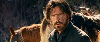 Tom Chaney (Josh Brolin) is not happy to see a familiar face in the wilderness.