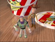 "Miniature kids' meal toys Buzz and Woody give Andy's toys only brief pause in an amusing series of ""Toy Story Treats"", Saturday morning interstitials scattered about Disc 2's menus."