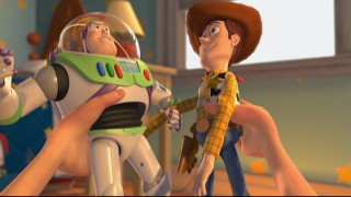 Andy gets his kicks out of playing with the unstoppable duo of Woody and Buzz Lightyear.