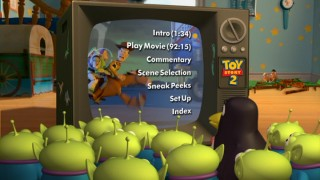 Background activity like this reveal of Mr. and Mrs. Potato Head liven up the otherwise simple Disc 1 Main Menus featuring Wheezy and the little green aliens watching highlights on Andy's TV.