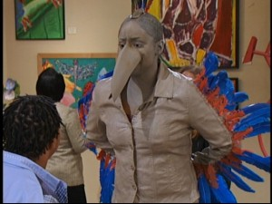 Raven Symone plays Raven Baxter playing a statue of Raven Baxter as a raven.