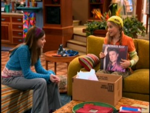 Miley and Lilly (Emily Osment) take a trip down memory lane and marvel at Billy Ray, er, Robbie Ray's past popularity.