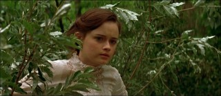 "Alexis Bledel plays Winifred Foster, the curious protagonist of ""Tuck Everlasting"", seen here walking through the woods."