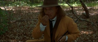 """A plane crashed here,"" deduces the mysterious Man in the Yellow Suit (Ben Kingsley)."