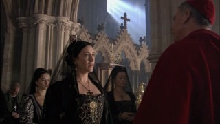 Queen Catherine of Aragon (Maria Doyle Kennedy) and Cardinal Wolsey (Sam Neill) engage in a showdown.