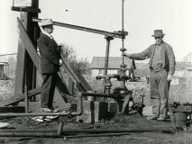 "1920s folks pump for oil in the silent short film ""The Story of Petroleum."""