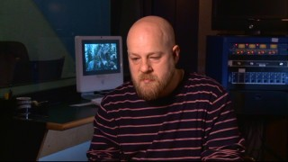 """Eclipse"" director David Slade looks down while explaining why some scenes have been cut and shortened."