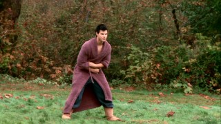 Between takes, Taylor Lautner keeps his figure by catching grapes in his mouth and staying warm in a purple bathrobe.