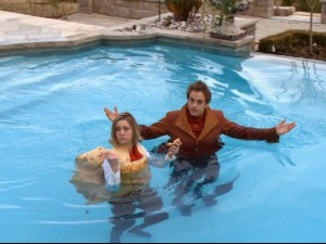 Karsh (Pat Kelly) and the new Ileana (Leslie Seiler) make a crash landing in the pool.