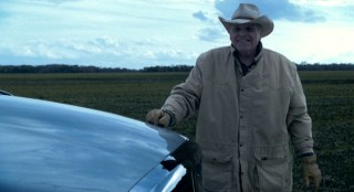 Rancher Gus (Brian Dennehy) is part of the first character-building challenge: manual labor in Texas.