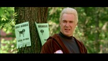 A squinty, bleached blonde Patrick Warburton posts signs looking for a lost beagle in this deleted scene.