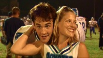 "James Van Der Beek sneaks up on Ali Larter while she discusses his fame in 1998 electronic press kit footage used in ""Football is a Way of Life."""