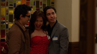 A.J. (Max Minghella) and Marty (Justin Long) relish an opportunity to get their picture taken with Anna (Lynn Collins).
