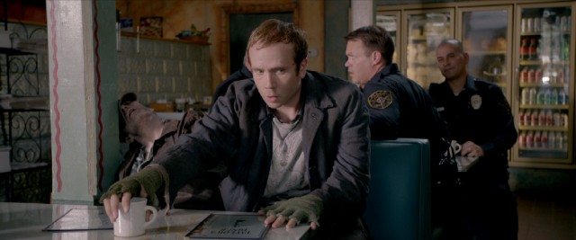 "In ""13 Sins"", Elliot Brindle (Mark Webber) is challenged to commit disturbing acts, like ordering coffee for a dead man."