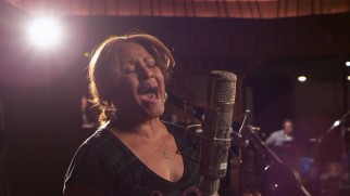 "Darlene Love gets to sing lead in the film's fitting closing performance of ""Lean on Me."""