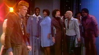 "David Bowie's ""Young Americans"" is cited as an example of song that makes prominent use of backup singers."