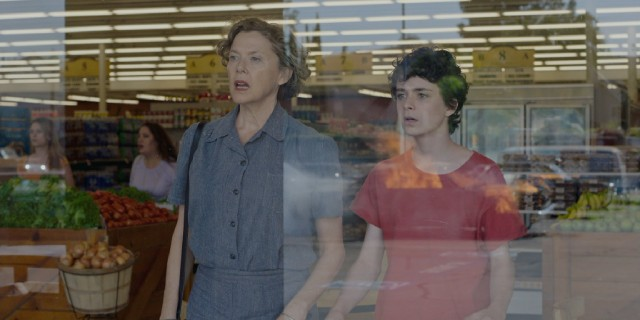 Dorothea (Annette Bening) and Jamie (Lucas Jade Zumann) see a car catch fire in the parking lot of a grocery store.