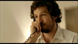 "Traveling businessman Jean-Paul Clement (Guillaume Canet) makes a call for companionship in the bonus 2008 short ""Voyage d'affaires."""