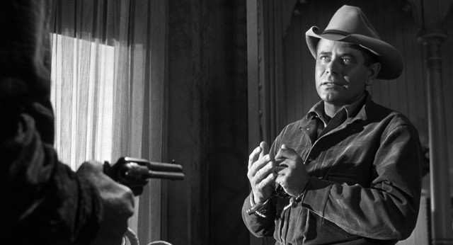 "Outlaw Ben Wade (Glenn Ford) is holed up in a Contention City hotel room awaiting transfer on the ""3:10 to Yuma"" in this 1957 Western."