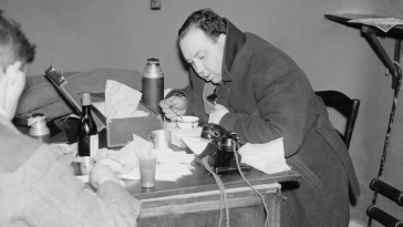 "A photo of Alfred Hitchcock huddled among tissues, soup, and a telephone features in the Leonard Leff visual essay ""The Borders of the Possible."""