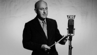 "This still of Cecil B. DeMille at a CBS microphone is one of a few that feature onscreen while Lux Radio Theatre's performance of ""The 39 Steps"" plays."