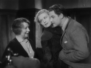Pamela (Madeleine Carroll) and Hanny (Robert Donat) pose as a newlywed couple as they try to hide the fact that they are handcuffed to one another from an innkeeper.