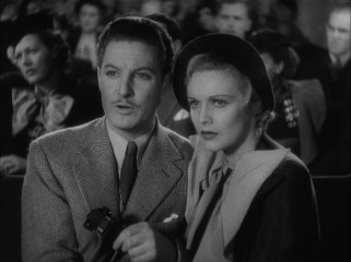 "The end of ""The 39 Steps"" brings Hannay (Robert Donat) and Pamela (Madeleine Carroll) close to solving the mystery at another Mr. Memory show."