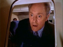 "John Lithgow pays homage to his segment in ""Twilight Zone: The Movie"" by seeing something on the wing of a plane in ""Frozen Dick."""