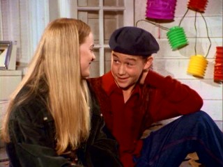 Tommy (Joseph Gordon-Levitt) charms his first season girlfriend August (Shay Astar) in a beret.