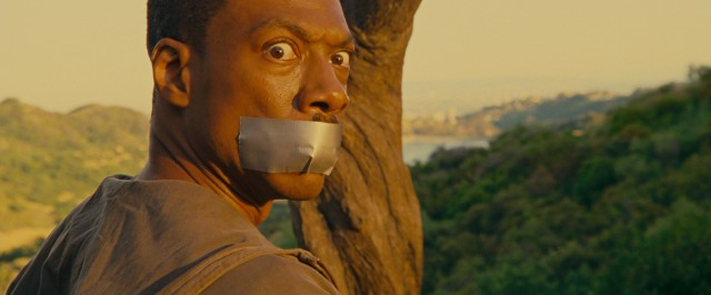 Duct tape over the mouth is one way to limit Jack McCall's (Eddie Murphy) speaking.
