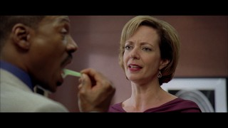 Jack (Eddie Murphy) tries flossing his way out of answering his boss (Allison Janney) in this deleted scene.