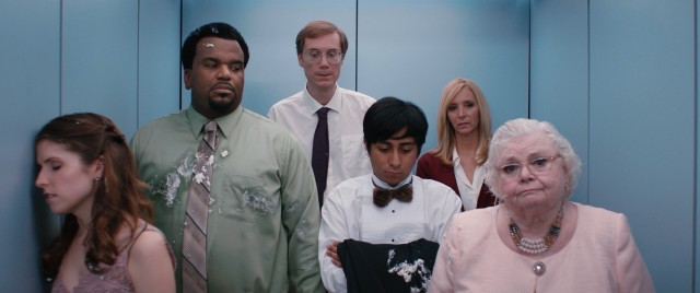 The misfits from Table 19 (Anna Kendrick, Craig Robinson, Stephen Merchant, Tony Revolori, Lisa Kudrow, and June Squibb) take an elevator ride to wash off the cake that got all over their fancy clothes.