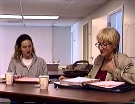 "Laura Linney and a white-haired Olympia Dukakis rehearse a Tales of the City"" scene at a table in the first of Disc 2's nine behind-the-scenes videos."