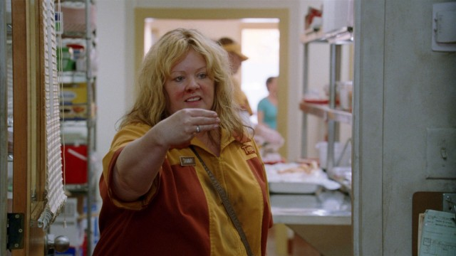 "In ""Tammy"", Tammy Banks (Melissa McCarthy) instructs the fast food boss who just fired her to read between the lines."