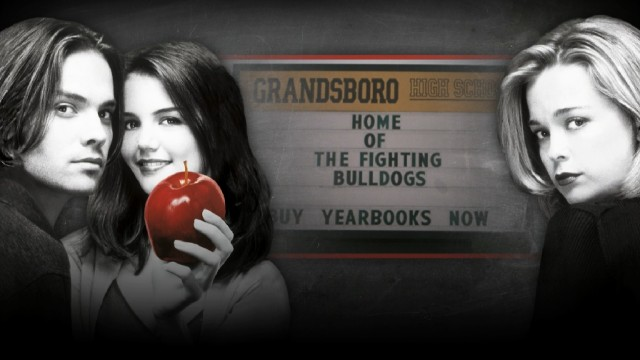 The Teaching Mrs. Tingle Blu-ray menu plays clips amidst the three members (Barry Watson, Katie Holmes, Marisa Coughlan) of Grandsboro High School's Class of 1999.