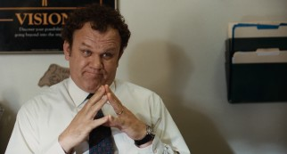 John C. Reilly plays sympathetic assistant principal Mr. Fitz(gerald), who listens in front of a motivational poster.